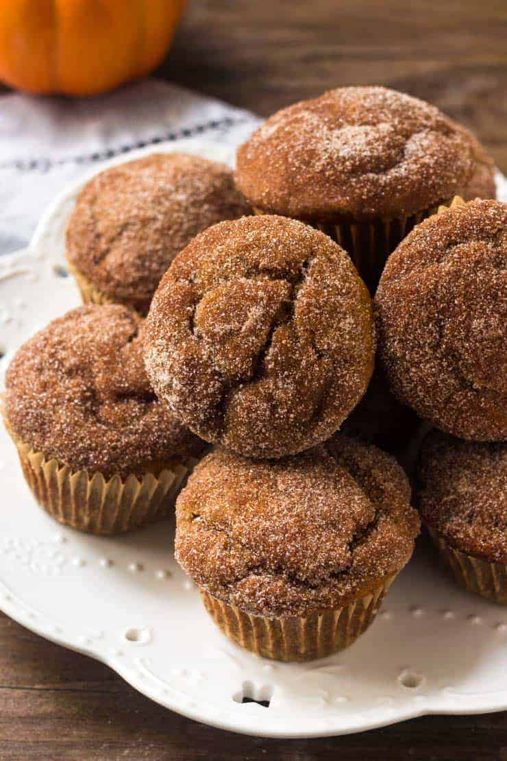 Moist pumpkin muffins are topped with delicious cinnamon sugar.