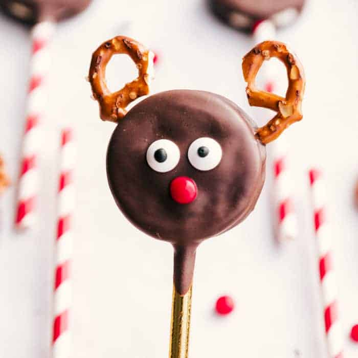 chocolate dipped oreos made into reindeer cookies.