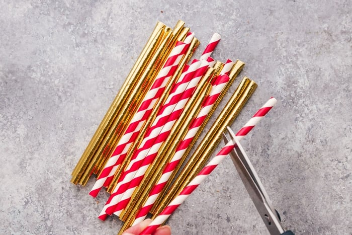 Straws used to hold up reindeer oreo cookies