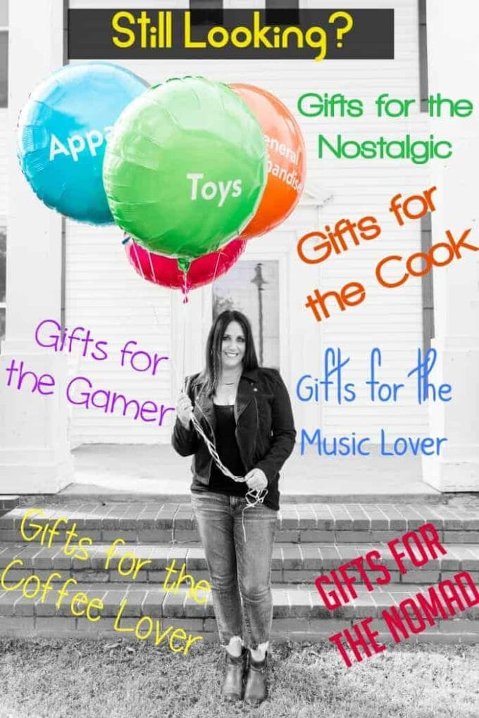 Woman holding balloons with writing about gift giving ideas