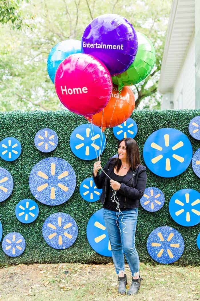 Walmart balloons in front of grass backdrop