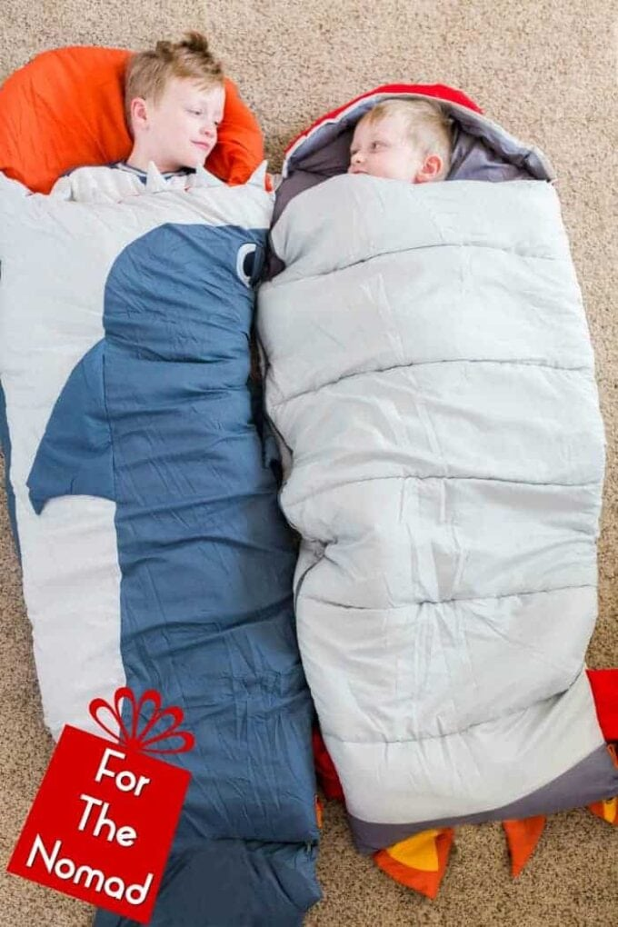 kids sleeping in rocket ship and shark sleeping bags