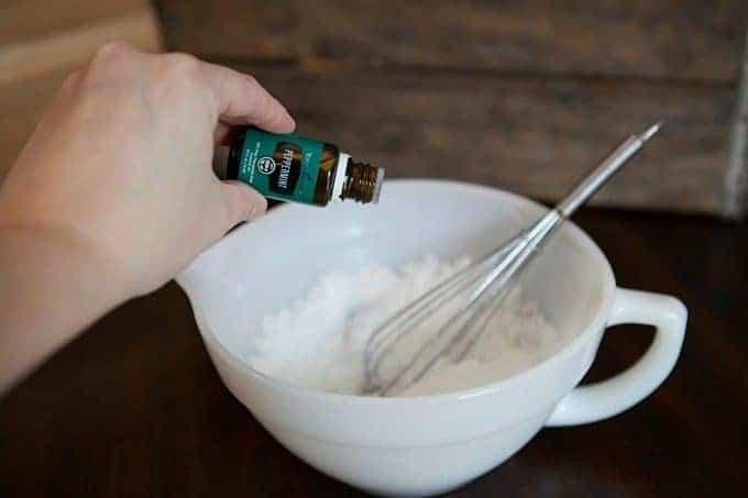 Peppermint Sugar Scrub in process putting peppermint essential oil into the scrub