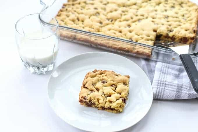 Chocolate Chip Cookie Bar on a white plate with milk