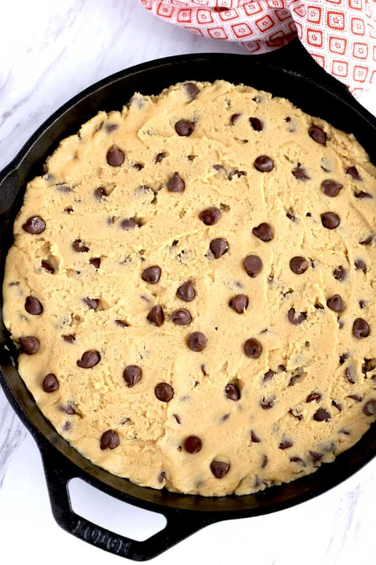 Cookie dough pressed into a skillet.