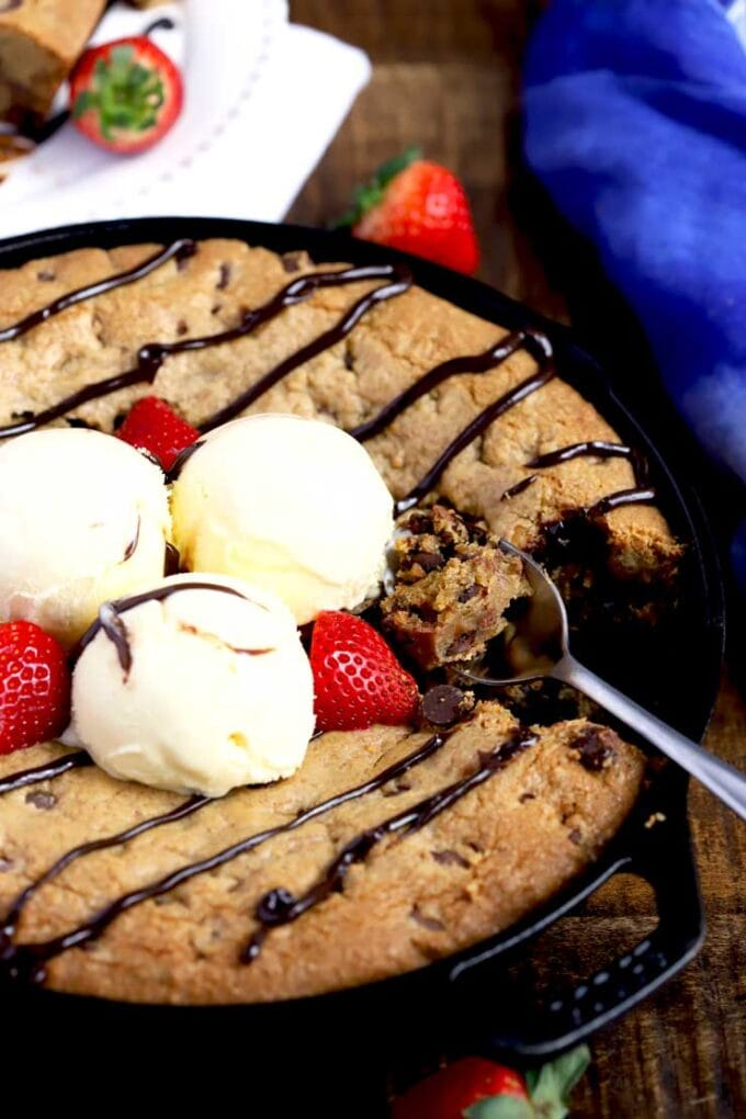 Skillet Cookie topped with ice cream and chocolate sauce.