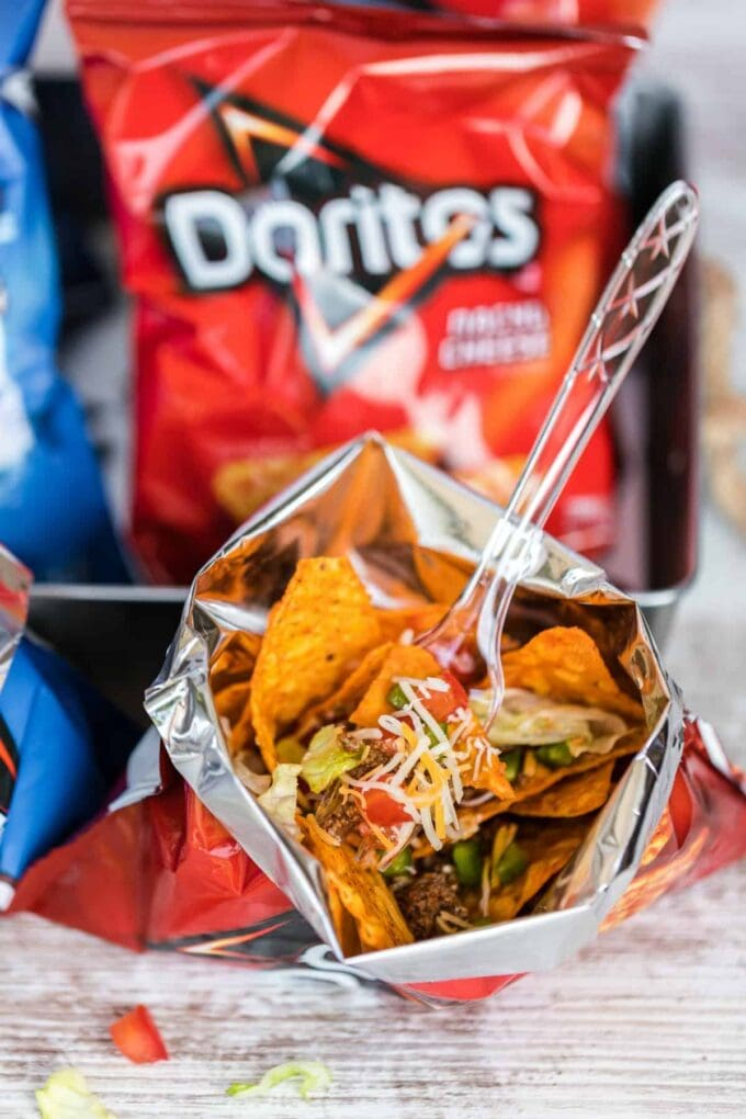taco ingredients in a bag in front of doritos