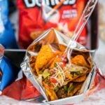 taco ingredients in a Doritos bag