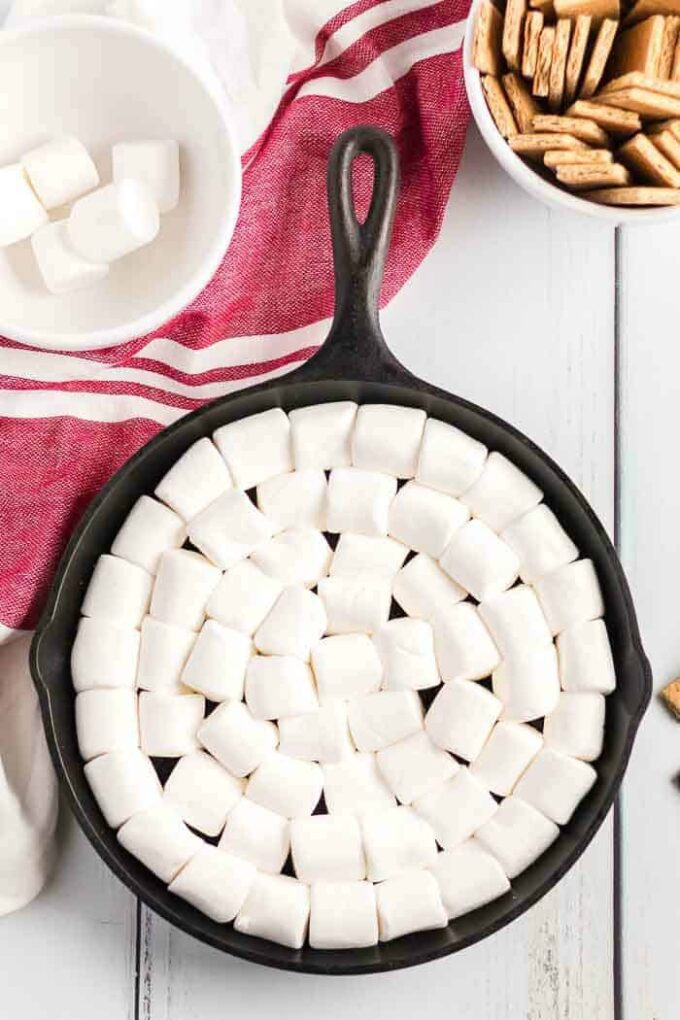 s'mores dip layer the marshmallows