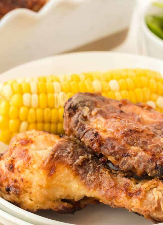 Air Fryer Fried Chicken on a plate with corn on the cob
