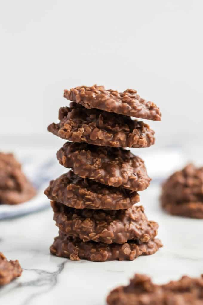 No Bake Chocolate Peanut Butter Cookies stacked on a marble table
