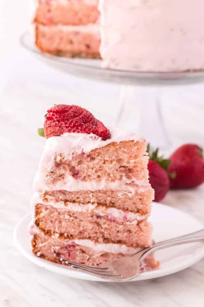 Strawberry cake slice with fresh strawberry on top
