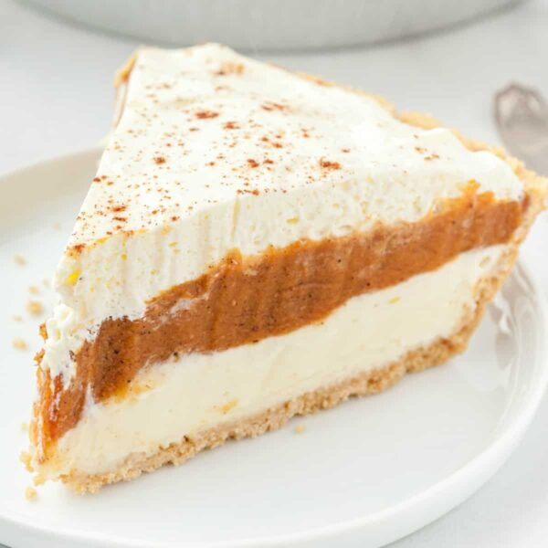 piece of pumpkin pie on a white plate