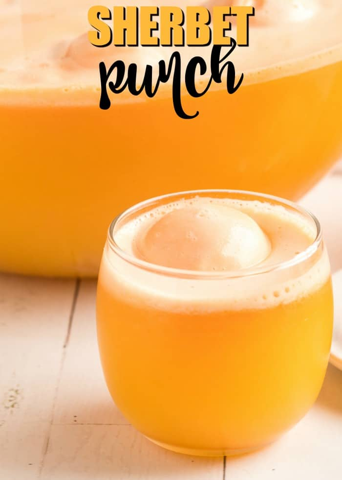 Orange Sherbet Punch in a glass with a scoop of sherbet
