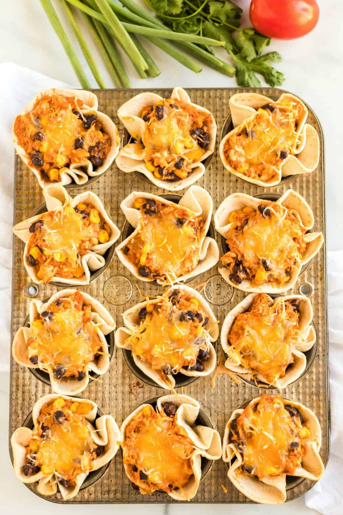 Enchilada Cups in a muffin pan