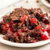 chocolate cherry dump cake on a white plate