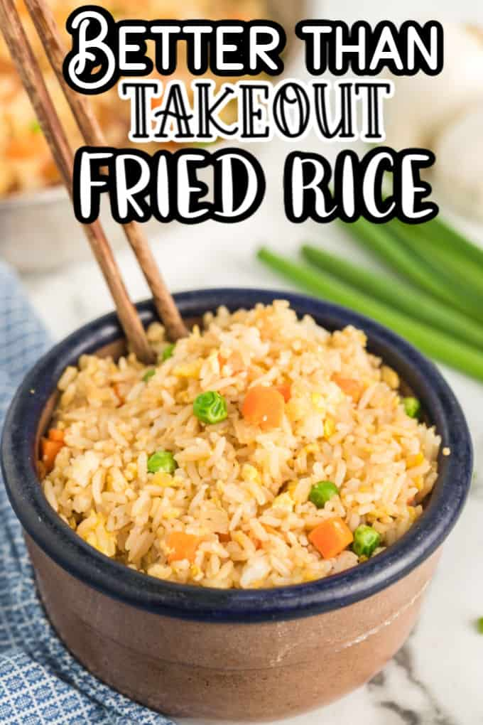 Better Than Takeout Fried Rice in a bowl with chop sticks