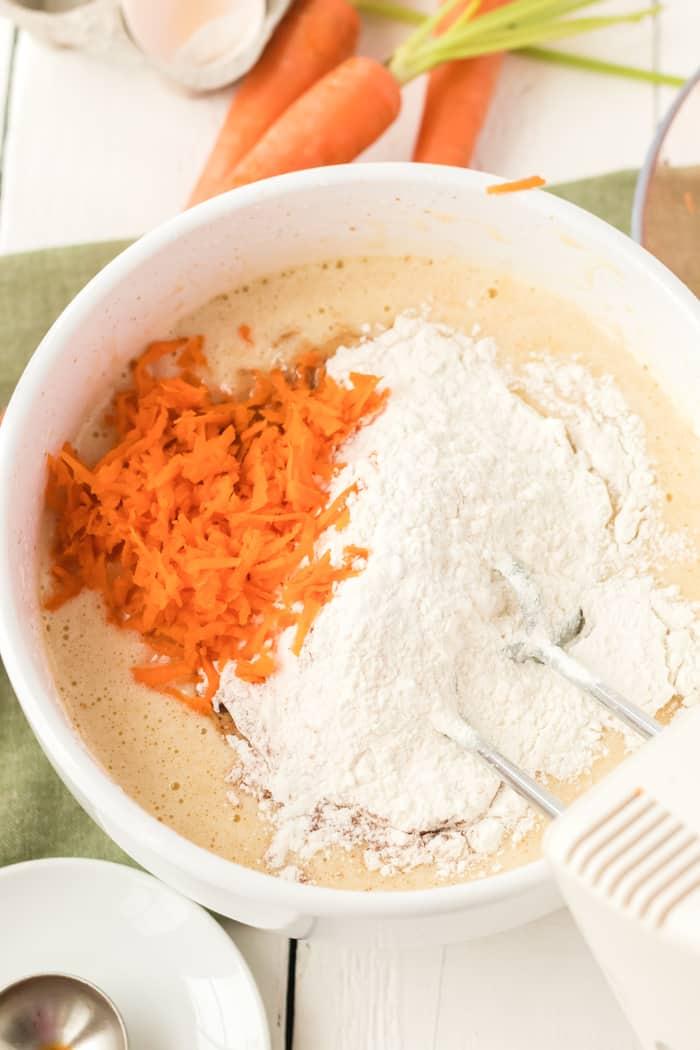 Mixing cupcake ingredients in a bowl