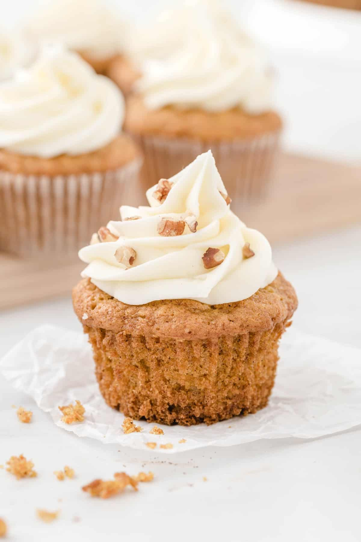 carrot cake cupcakes sprinkled with nuts
