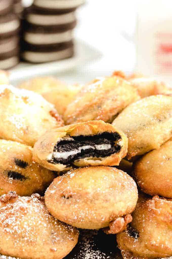 Deep Fried Oreos in a pile with a bite out of one