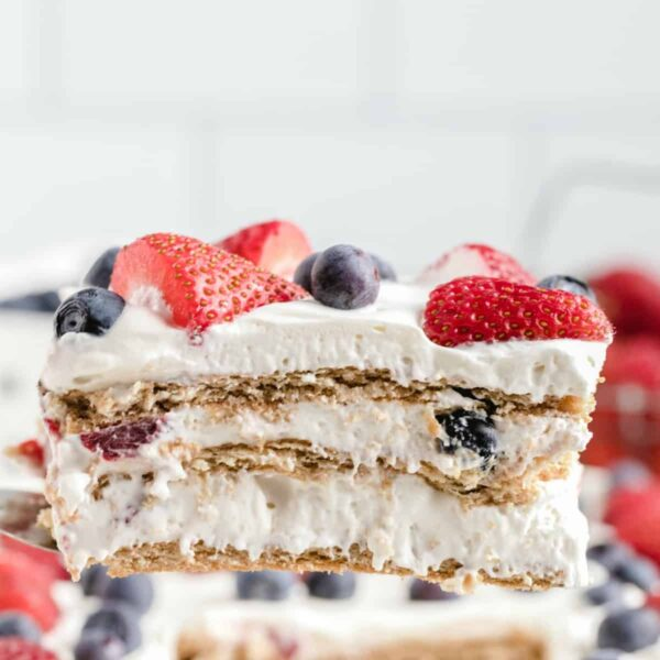 Berry Icebox Cake featured image sliced on a spatula