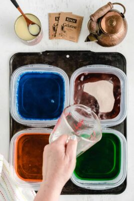 Dissolve each box of jello into its own small plastic container