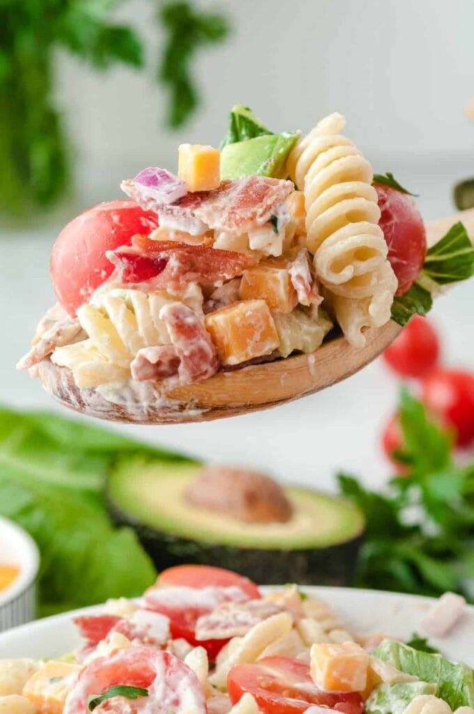pasta salad on a wooden spoon
