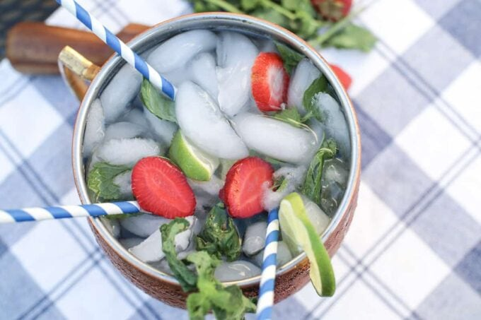 moscow mule with ice, strawberries, mint leaves and lime