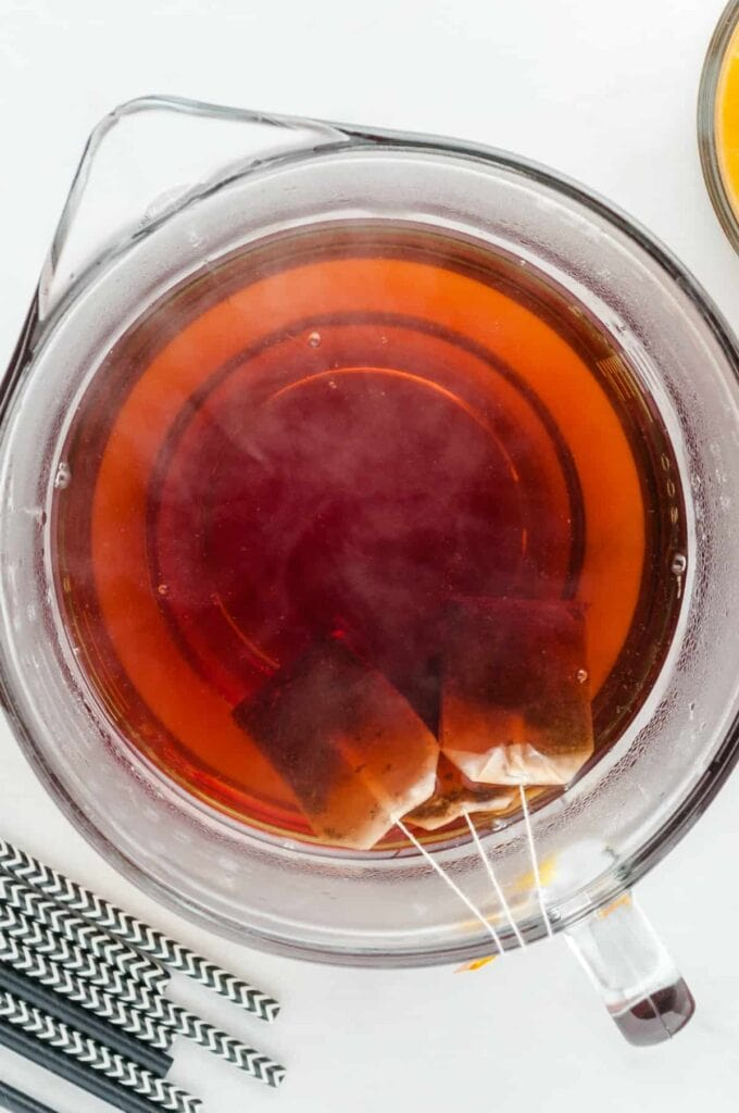 brewing iced tea in a glass bowl