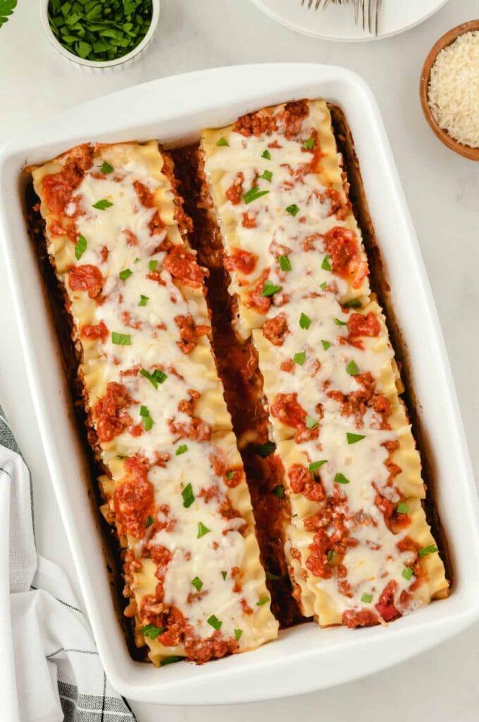 Lasagna Roll-Ups in a white casserole dish