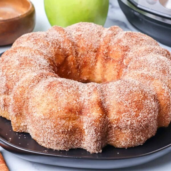 Apple Cider Doughnut Cake on a black plate