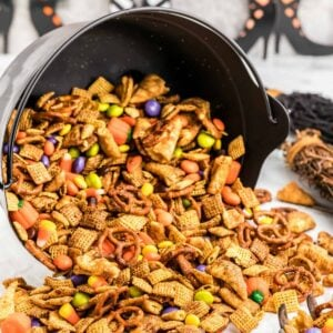 Halloween Chex Mix in a bowl spilling out