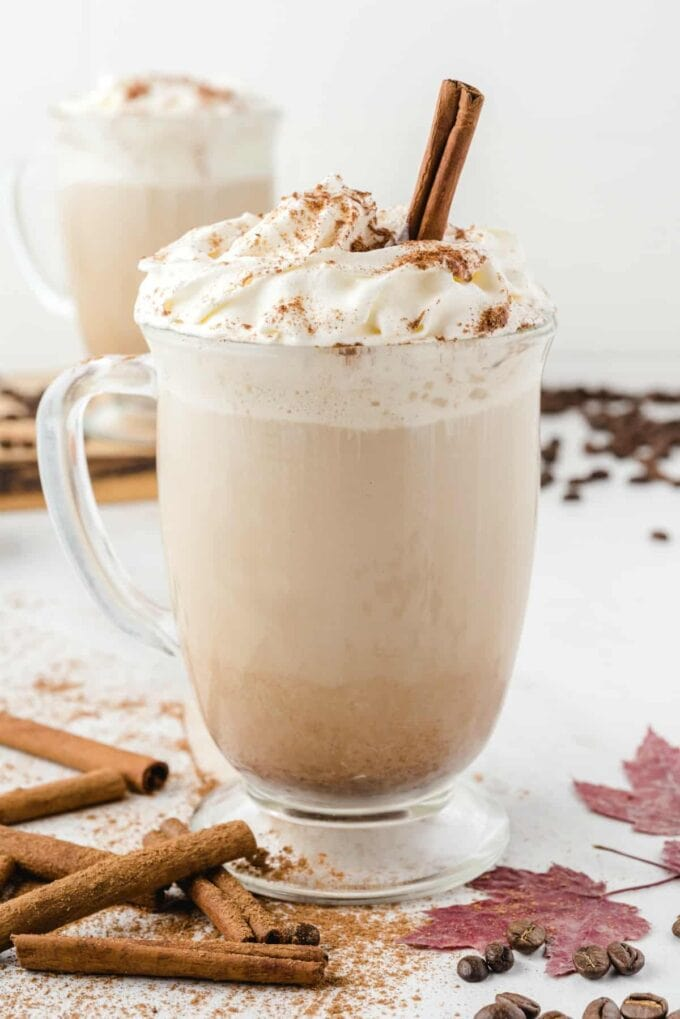 Homemade Pumpkin Spice Latte with whipped cream and cinnamon sticks