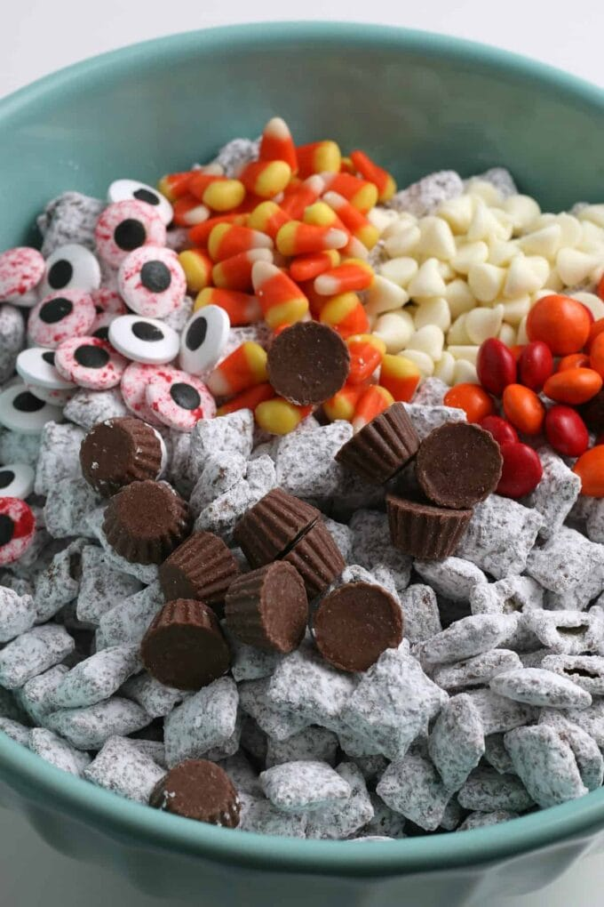 candy and muddy buddies in a bowl