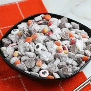Halloween Puppy Chow in a black bowl