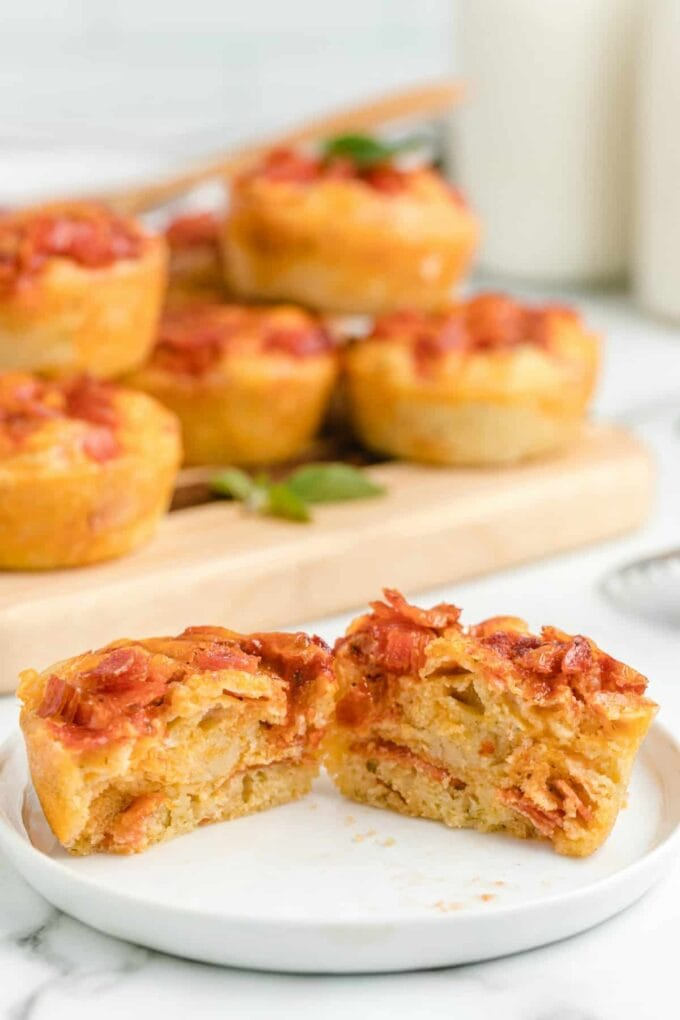 pizza muffin cut in half on a white plate