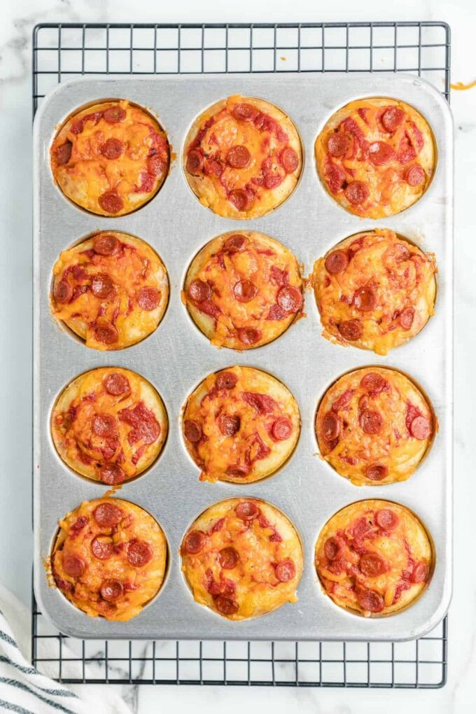 cooked pizza muffin still in muffin tin