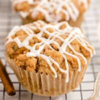 pumpkin muffin with icing on a wire rack