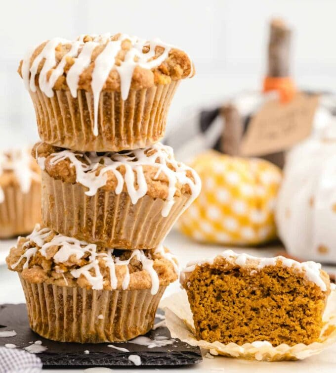 pumpkin muffins stacked and one cut open