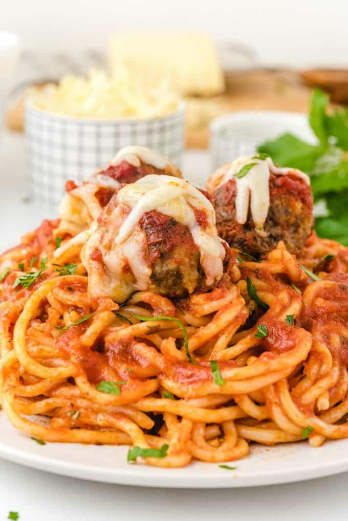 baked spaghetti and meatballs on a plate