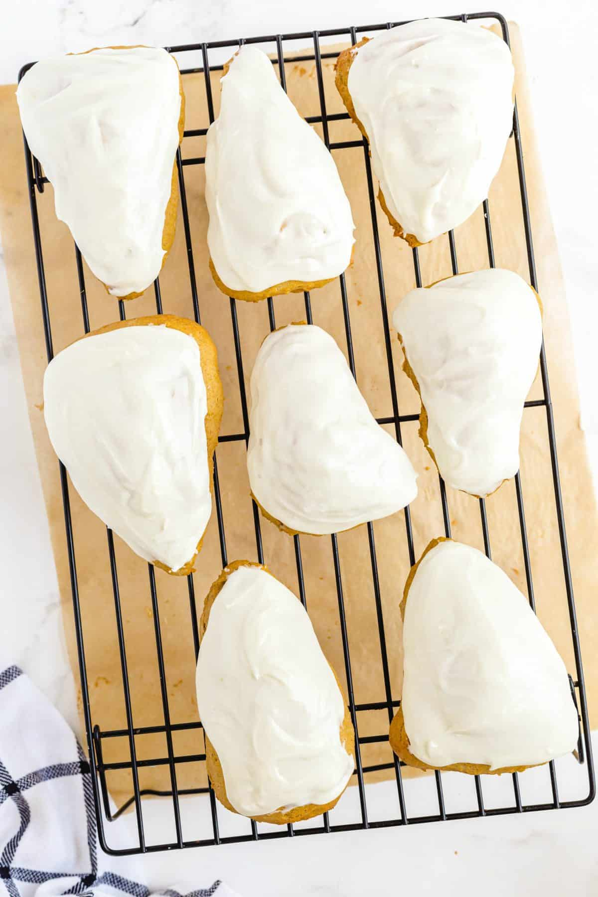 scones with frosting on a wire rack