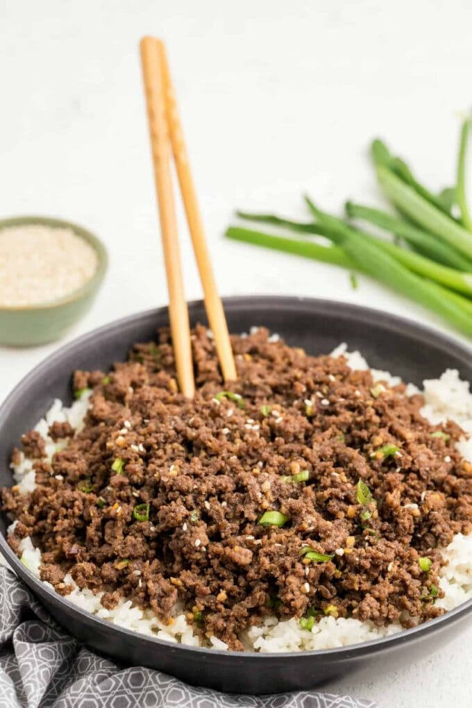 Korean Beef Bowl with chopsticks and green onion