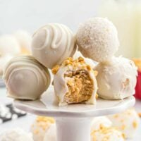 White Chocolate Peanut Butter Truffles on a cake plate