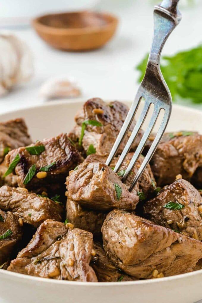fork picking up steak bites