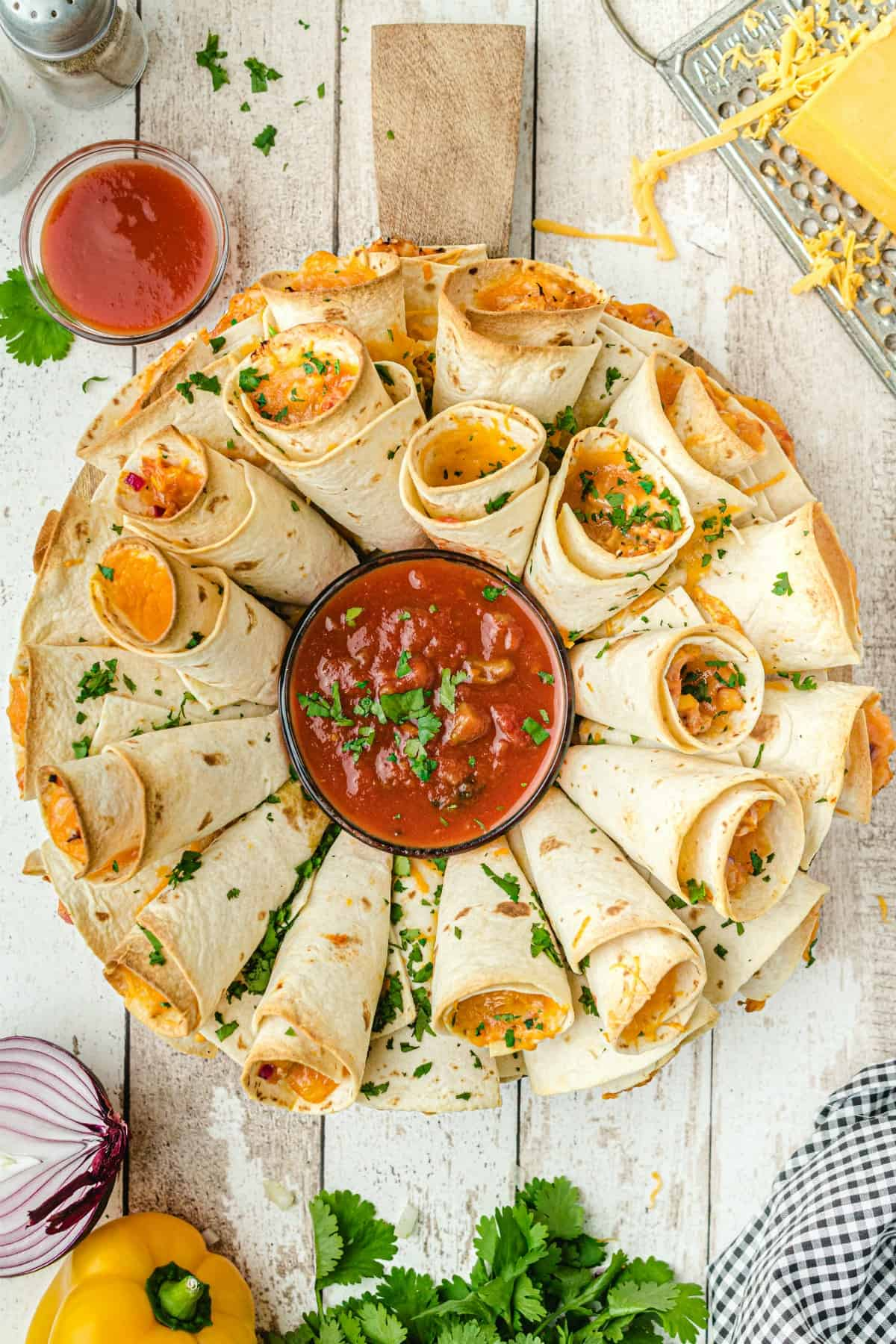 Blooming Quesadilla Ring on a platter with salsa