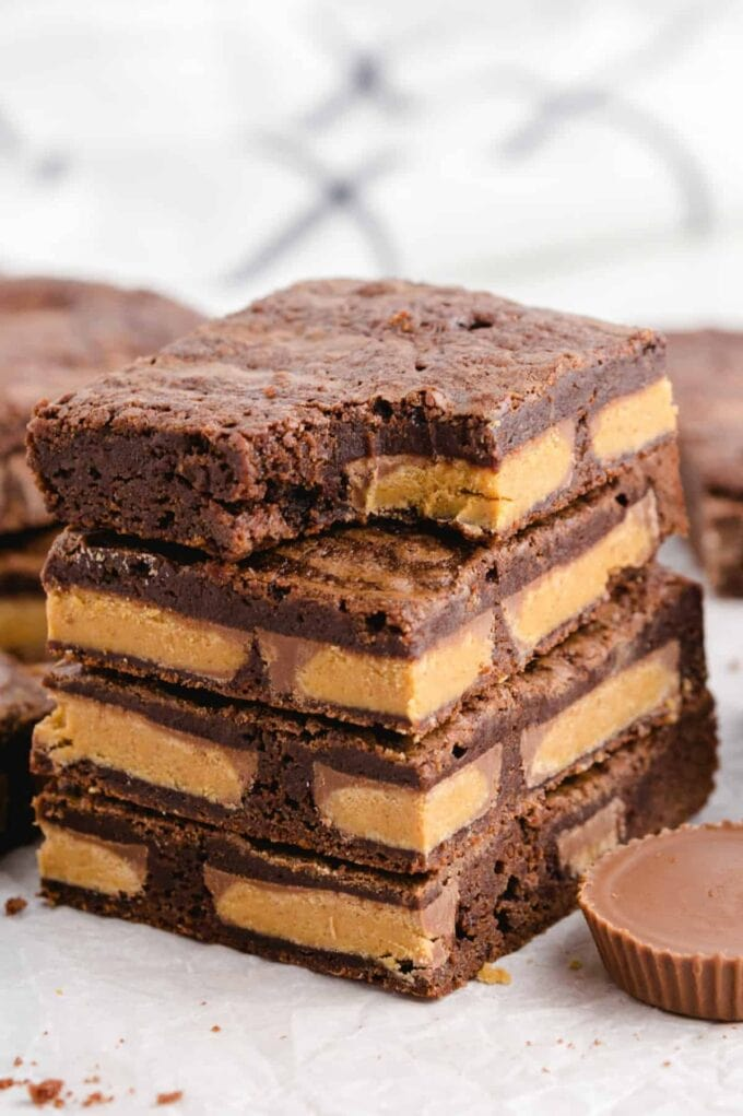 Peanut Butter Cup Brownies stacked with a bite
