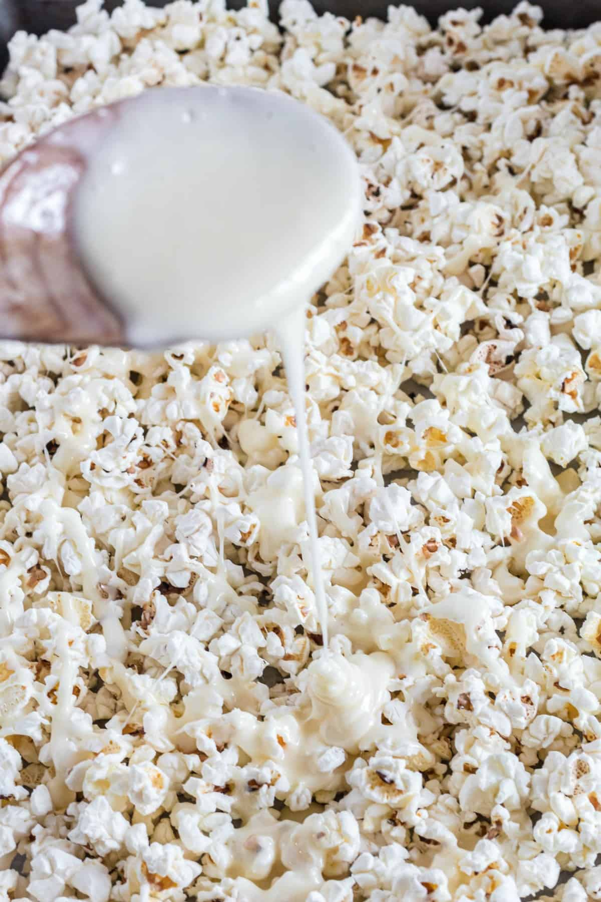 Popcorn drizzled with white chocolate