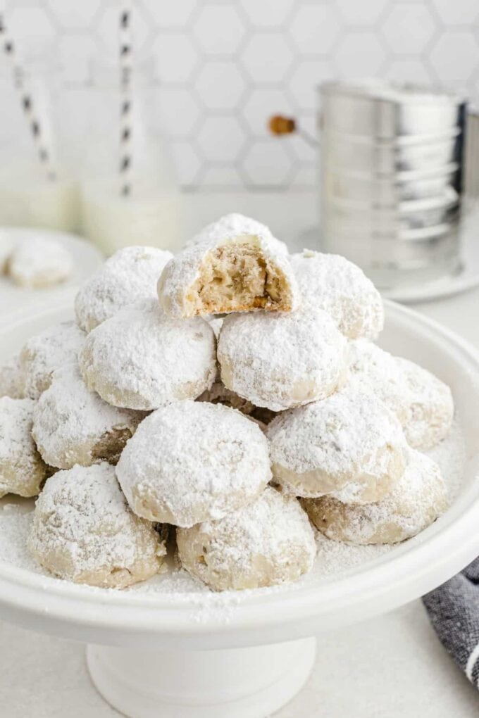 snowball cookies on a cake plate