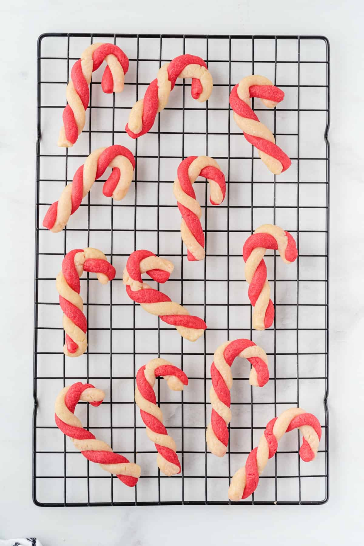 candy cane cookies on wire rack