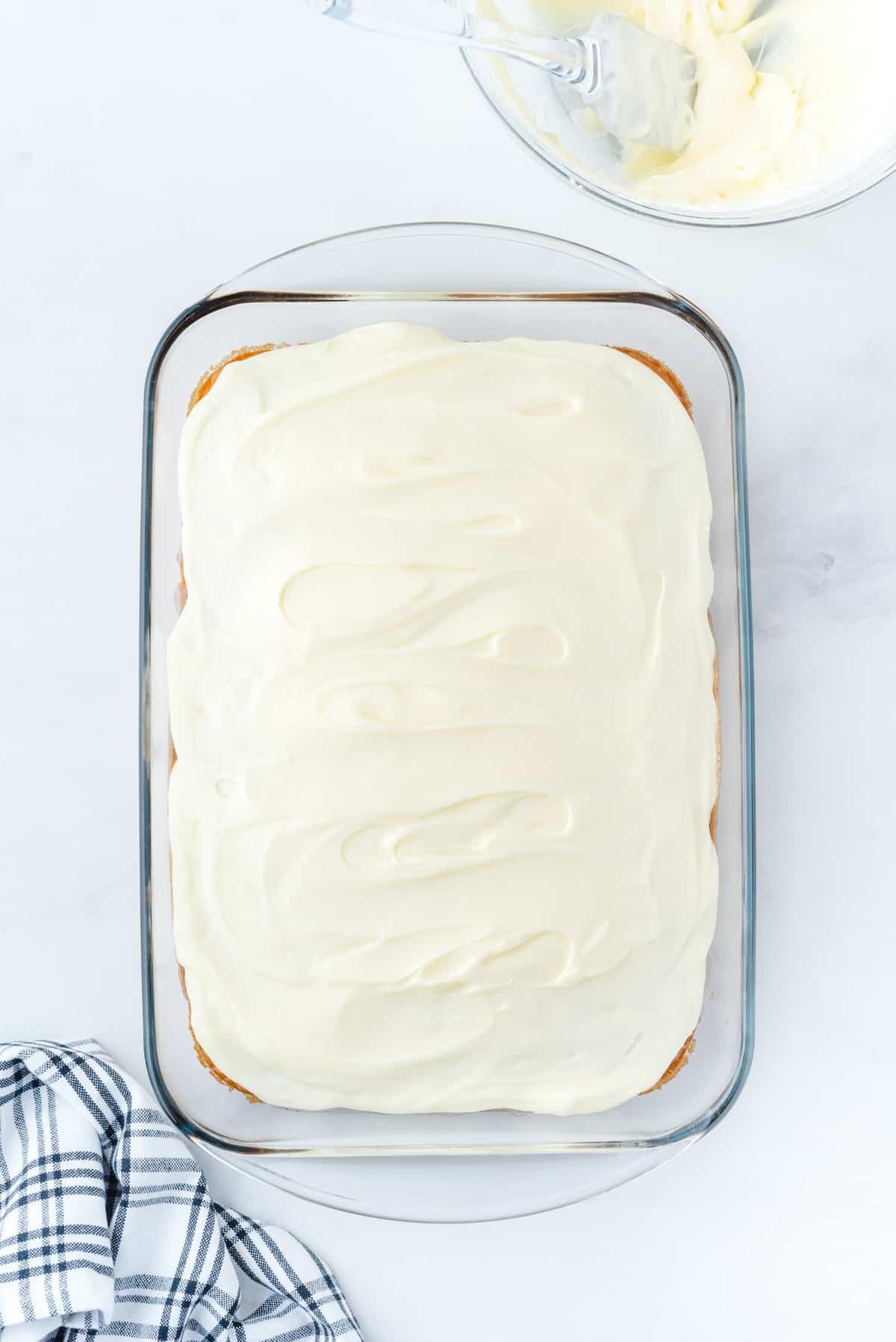 cinnamon roll poke cake frosted